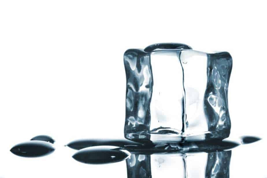 ice cube with water drops on white